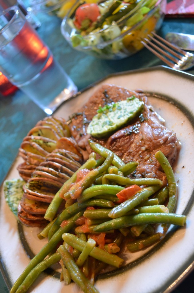 Beef steak, hasselback potatoes, green beans and wild garlic butter recipe for mother's day by ginger, lemon and spice
