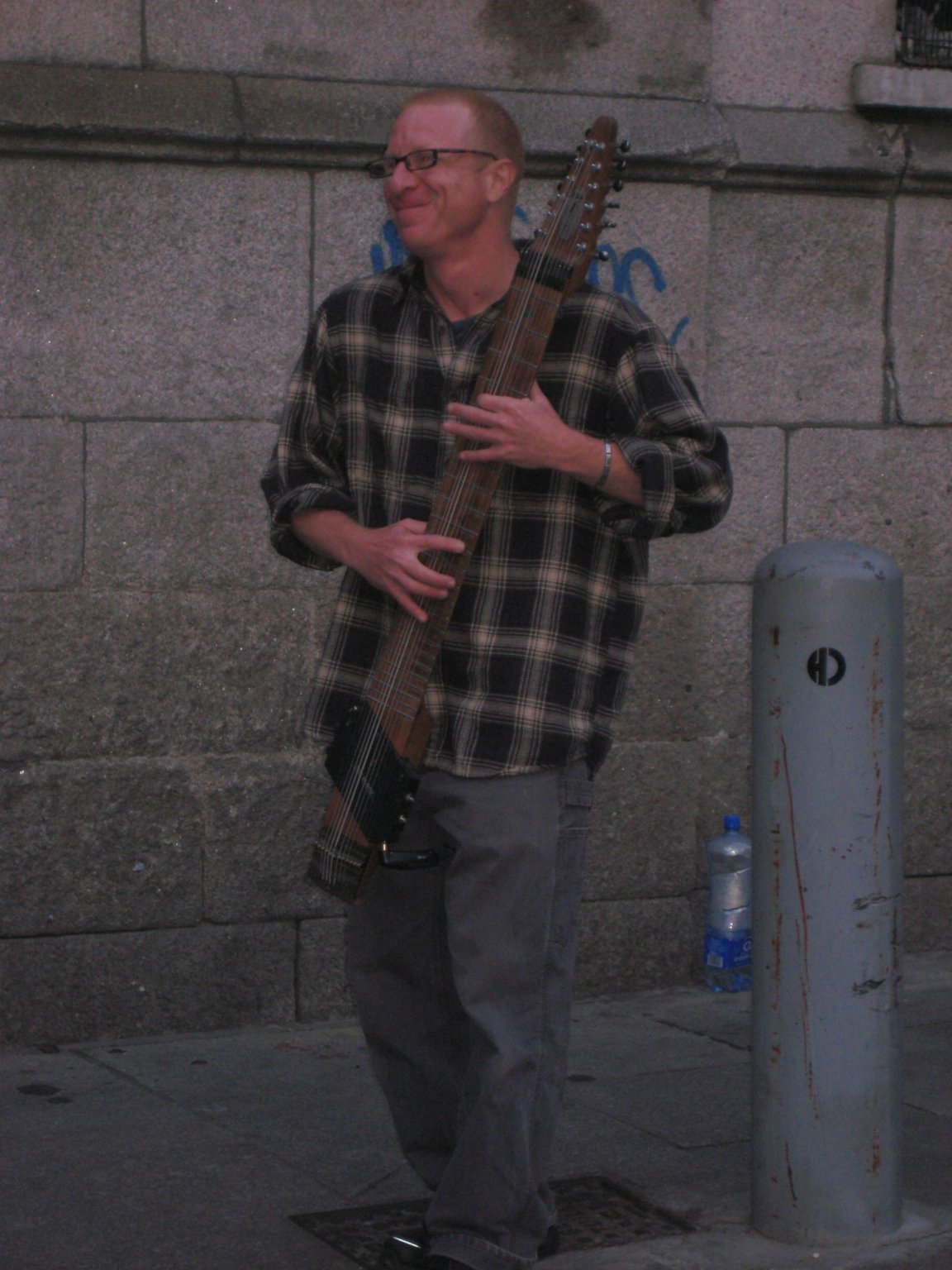 street musician with funny instrument in Dublin Templebar